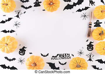 Top view of Halloween crafts, yellow pumpkin, ghost, bat and spider on white background with copy space for text. halloween concept.