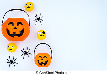 Top view of Halloween decoration, jack o lantern, ghost, bat and spider on white background with copy space for text. halloween concept.