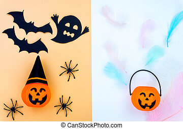 Top view of Halloween decoration, jack o lantern, ghost, bat and spider on yellow and white background with copy space for text. halloween concept.