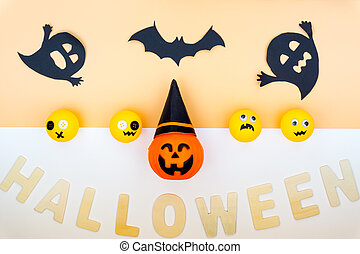 Top view of Halloween decoration, jack o lantern, ghost, bat and spider on yellow background with copy space for text. halloween concept.