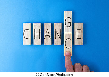 person changing the word CHANGE into CHANCE