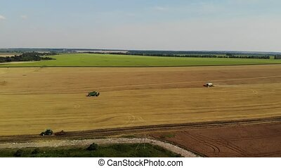 Top view of harvesters in field, Russia
