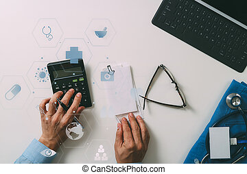 top view of Healthcare costs and fees concept.Hand of smart doctor used a calculator for medical costs in modern hospital with VR icon diagram