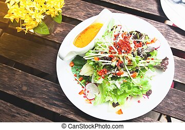 Top view of Healthy Salad on wooden table, Healthy lifestyle concept