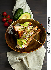 Top view of Healthy Sandwich toast with lettuce, ham, cheese and tomato on a wooden background