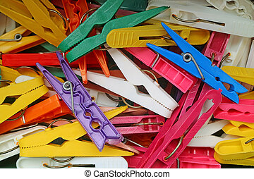 Top view of heap of colorful clothespins