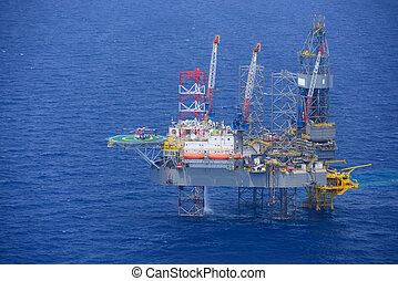helicopter pick up passenger on the offshore oil rig.
