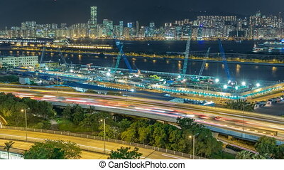 Top view of Hong Kong at night, View from kowloon bay downtown timelapse