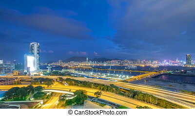 Top view of Hong Kong day to night, View from kowloon bay downtown timelapse