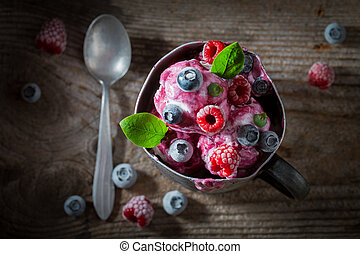 Top view of ice cream with fresh berries