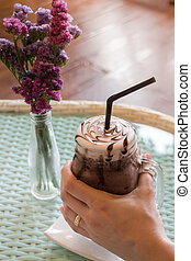 Top View Of Iced Chocolate On Glass Table