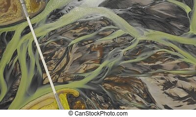 Top view of Icelandic glacier melt water river delta