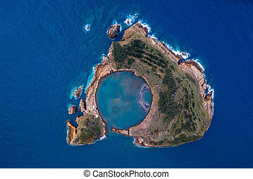 Top view of Islet of Vila Franca do Campo is formed by the crater of an old underwater volcano near San Miguel island, Azores archipelago, Portugal.