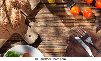 Top view of italian food on wooden table - bread, olive oil...