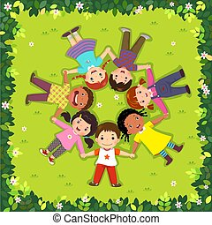 Top view of kids lying on the grass in a circle