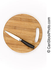 Top view of kitchen knife on the wooden board