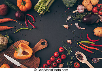 top view of knife and cutting board with vegetables