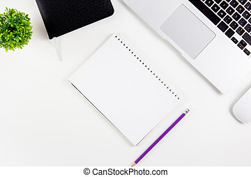 Top view of laptop computer with open display screen monitor, diary and mouse and notepad, glasses and pencil isolated on white background, notebook or netbook with keyboard, communication technology concept.
