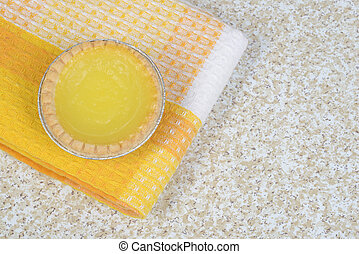 lemon tart on yellow napkin