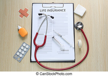 Top view of life insurance policy with stethoscope, hypodermic syringe, plaster, gauze, tincture and tape