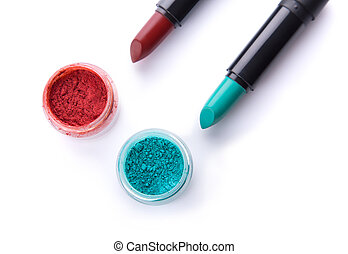 Top view of lipsticks with matching eye shadows