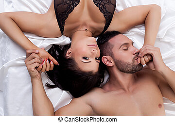 Top view of loving young couple in bed