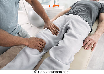 Top view of male hands doing a massage