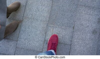 Top view of male legs in sneakers, which go along the...