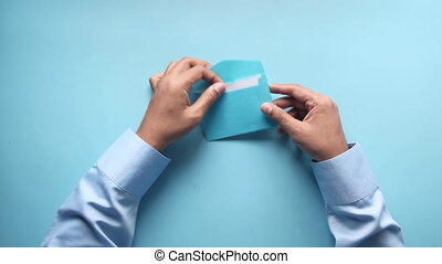 top view of man hand reading a thank you letter .