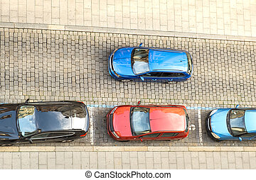 Top view of many cars parked on a city street.