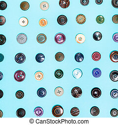 many different buttons arranged on blue background