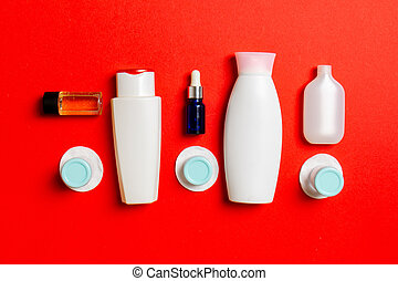 Top view of means for face care: bottles and jars of tonic, ...