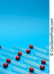 top view of medicine test tubes for blood samples over blue background