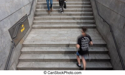 Metro stairs blurred people time lapse - Top view of Metro...