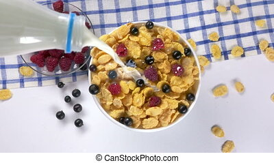 Top view of milk and corn flakes for morning breakfast cereal