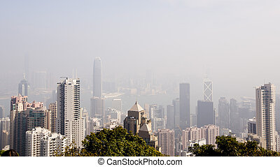 Top view of modern city in fog