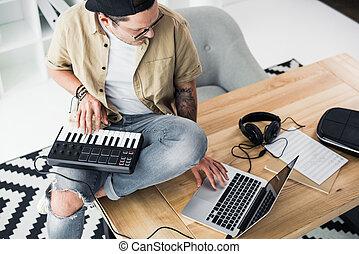 modern dj working with MPC pad