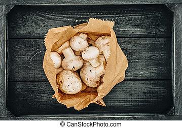 top view of mushrooms in shopping paper bag