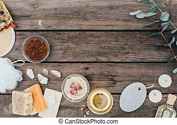 top view of natural soap, spa treatment and salt scrub on wooden table