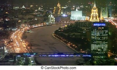 top view of night ?Bagration? bridge and office block ?Tower 2000? in Moscow