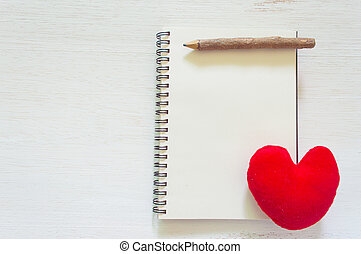 top view of notebook with heart