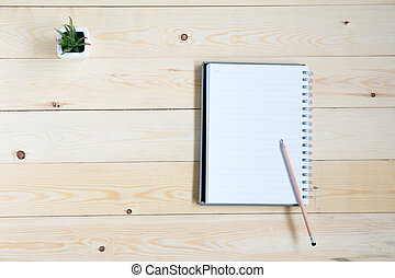 Top view of notebook with pencil