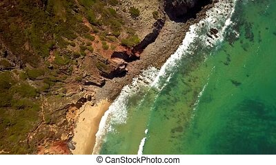 Top view of ocean and coastline - From above aerial shot of...