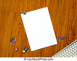 Top view of office desk with paper