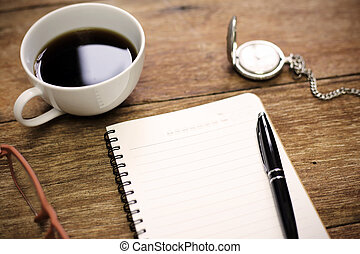 top view of office table with notebook blank paper pen cup of coffee copy space