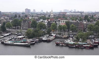 Top view of old Amsterdam city at summer