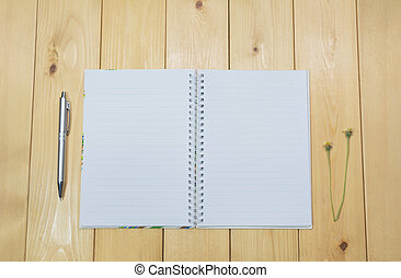 Top view of open book. Book open on wooden table background.