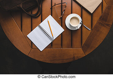 notepad with pencil and coffee