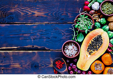 fr - Top view of organic vegetables and fruits, seeds, nuts,...