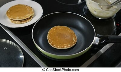 Top view of pancake flipped on frying pan - Top view...